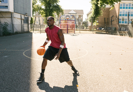brixton: Young man practising on basketball court