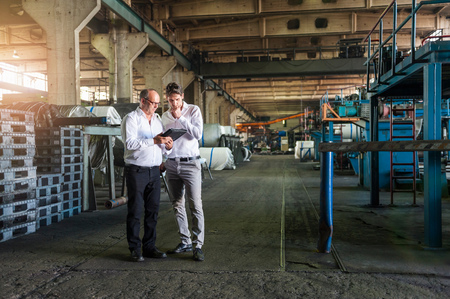 conferring: Colleagues conferring in tyre manufacturing plant, Ballenstedt, Germany