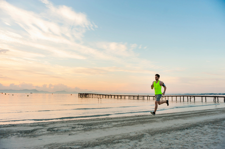 mid morning: Man jogging on beach, Mallorca, Spain LANG_EVOIMAGES