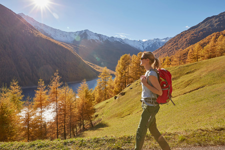 Woman hiking, looking at view, Schnalstal, South Tyrol, Italy