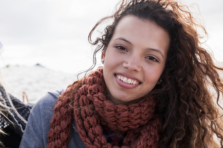 Portrait of young woman at beach, Western Cape, South Africa LANG_EVOIMAGES