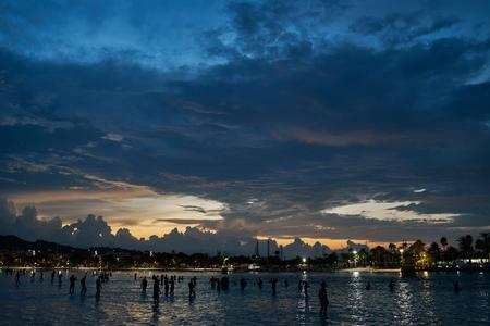 mallorca: Silhouette of crowd of people in sea at sunrise, Alcudia, Mallorca, Spain