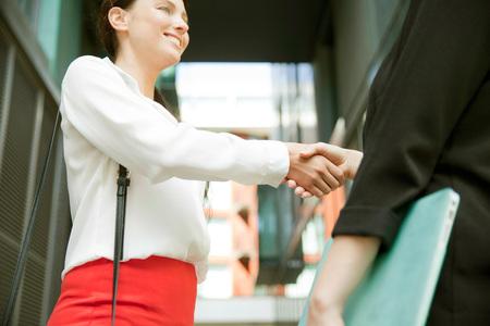 Businesswomen shaking hands at meeting, London
