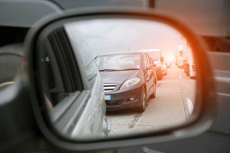 inconvenience: Wing mirror view of rows of traffic queueing on highway LANG_EVOIMAGES