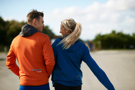 Rear view of couple face to face smiling