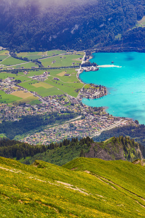 Elevated view of village in valley by river, Brienzer Rothorn, Bernese Oberland, Switzerland