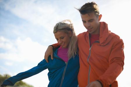 Couple walking together smiling LANG_EVOIMAGES