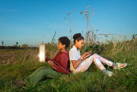 Children using miniature solar cell to power digital tablet, Breda, Netherlands