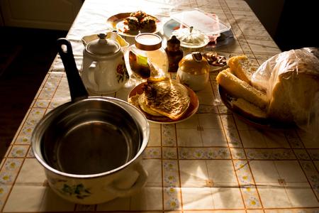 ural: Breakfast food, teapot and saucepan on table