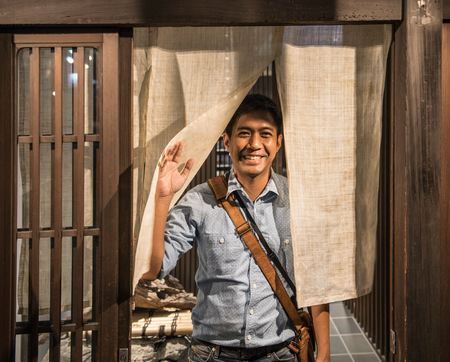 one mature man only: Man stands at door of traditional Japanese house