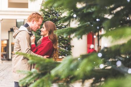 Couple hugging, Covent Garden, London, UK