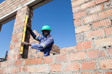 Builder working on construction site LANG_EVOIMAGES
