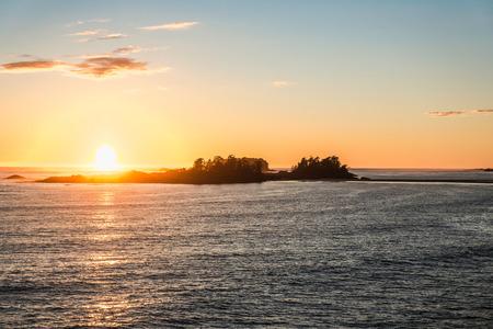 Sunset on sea horizon, Pacific Rim National Park, Vancouver Island, British Columbia, Canada LANG_EVOIMAGES
