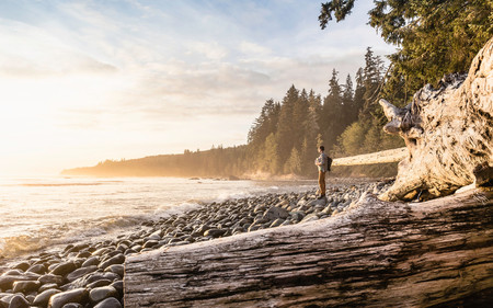 Man looking out from beach in Juan de Fuca Provincial Park, Vancouver Island, British Columbia, Canada