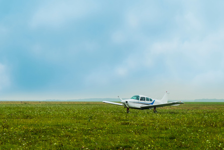 Light aircraft flying parked on airfield