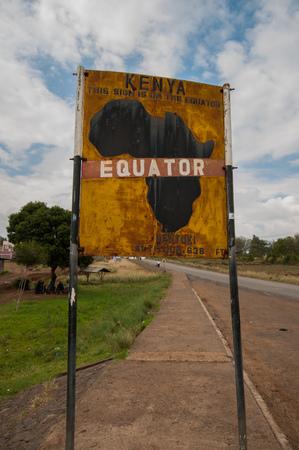 Sign marking the equator line dividing north and south hemispheres, Nanyuku, Kenya