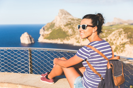 Woman enjoying view from cliff, Mallorca, Spain