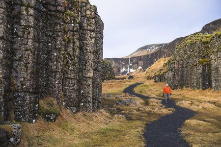 Man walking along pathway,Dvergahamrar,Iceland LANG_EVOIMAGES
