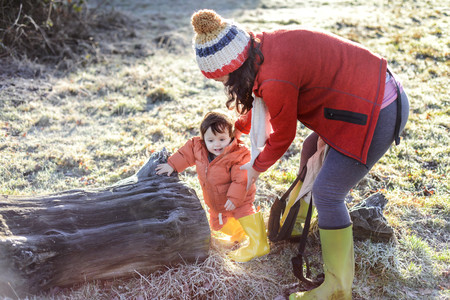 Mother steadying baby boy,outdoors,in winter LANG_EVOIMAGES