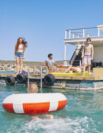 Family having fun on houseboat sun deck,Kraalbaai,South Africa