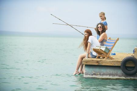 Family fishing on houseboat deck,Kraalbaai,South Africa
