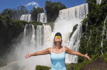 Woman posing in front of Iguazu falls,Misiones,Argentina