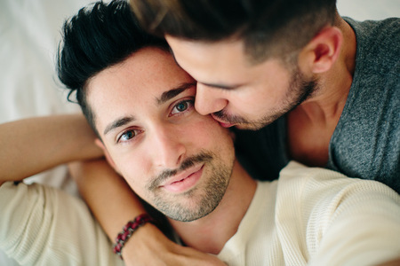 age 25 30 years: Portrait of male couple,man kissing partner on cheek