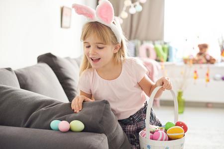 skirts: Girl finding easter eggs on sofa