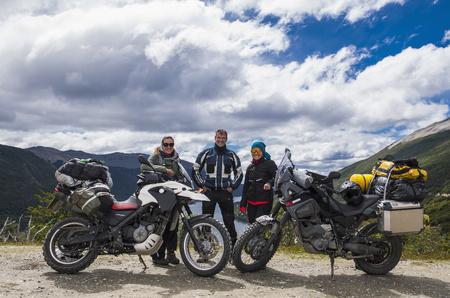 Three bikers posing behind their motorbikes in Tierra del Fuego,Argentina LANG_EVOIMAGES