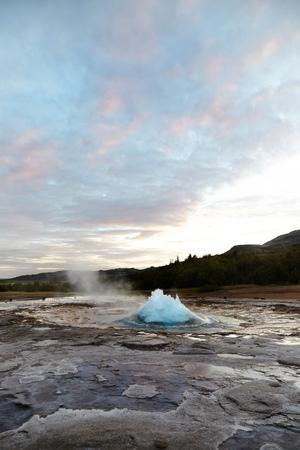 Dawn landscape with geyser erupting, Iceland LANG_EVOIMAGES