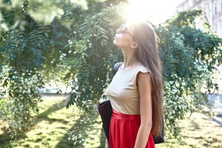 Woman enjoying sun LANG_EVOIMAGES