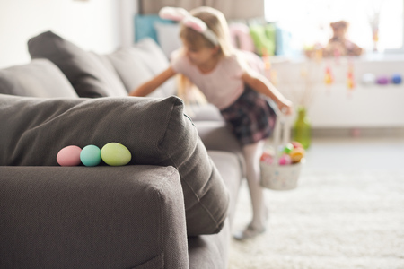 skirts: Girl searching for easter eggs on sofa