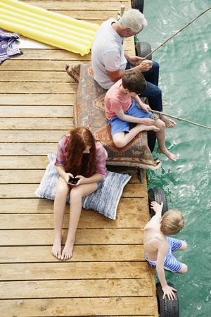 Family fishing on houseboat sun deck,Kraalbaai,South Africa