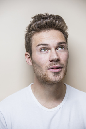 Studio portrait of handsome mid adult man with hair quiff