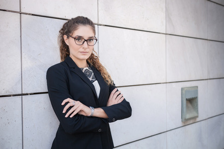 Portrait of young businesswoman,arms folded