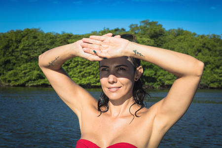Woman by sea, Fortaleza, Ceara, Brazil, South America LANG_EVOIMAGES