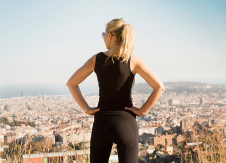Woman looking at view from Tibidabo, Barcelona, Catalonia, Spain LANG_EVOIMAGES