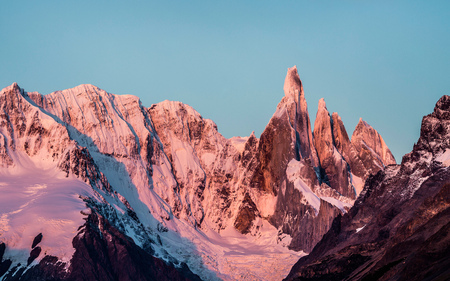 Pink sunset view of Cerro Torre and Fitz Roy mountain ranges Los Glaciares National Park, Patagonia, Argentina LANG_EVOIMAGES