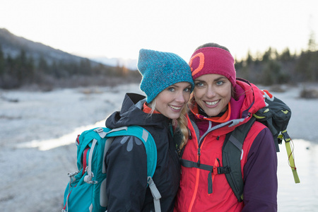 Portrait Of Two Female Hikers On Lakeside In Bavarian Alps