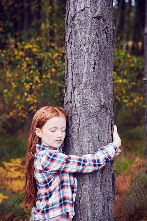 Young Girl, Hugging Tree