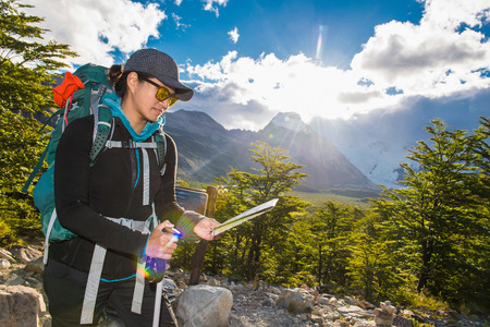 Female Hiker Checking Map On The Way Up To Mt. Fitz Roy, El Chalten, Santa Cruz Province, Argentina
