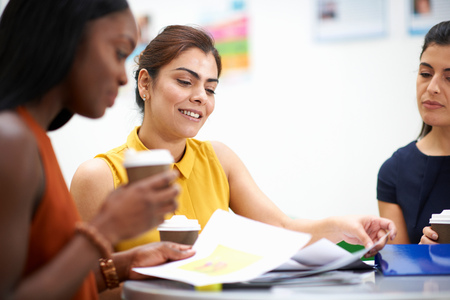 Business Women With Paperwork In Meeting