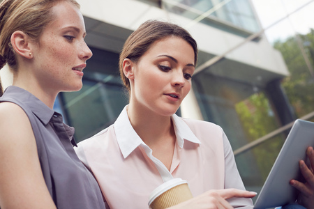 Business Women Having Discussion On Coffee Break, London, Uk