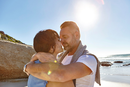 Mature Couple Hugging On Beach, Cape Town, South Africa