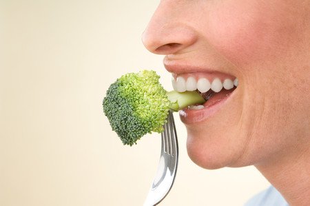 one mature woman only: A Woman Eating Broccoli