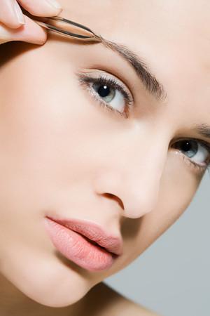 grooming product: Woman Plucking Eyebrow