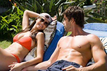Hispanic Couple Sunbathing