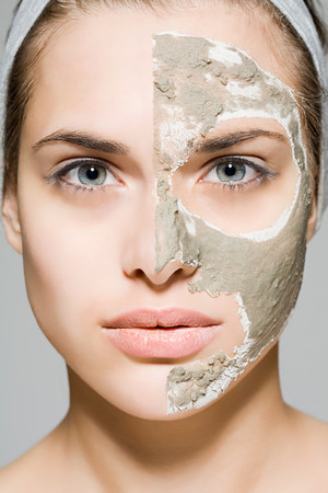 grooming product: Woman With Face Mask On Half Of Her Face