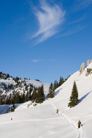 ski walking: A Man Walking Up A Mountain