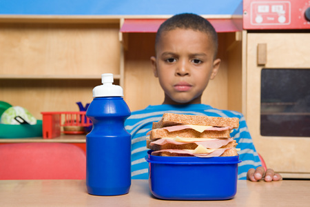 Boy Looking At Lunch Box LANG_EVOIMAGES